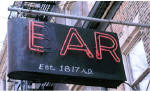 "For decades, the neon sign in front of the Ear Inn flashed ""Bar.""  To avoid landmarks review for any new sign, the ends of the ""B"" were painted over to rename the pub once only known as ""The Green Door.""  The new name came from the ""Ear"" music magazine published upstairs from 1975 to 1992."